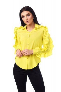 Яскрава блуза з рюшами